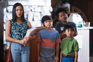 """In this image released by ABC, Constance Wu, from left, Forrest Wheeler, Hudson Yang and Ian Chen appear in a scene from the new comedy series """"Fresh Off the Boat,"""" previewing Wednesday with episodes at 8:30 p.m. and 9:30 p.m. EST. (AP Photo/ABC, Jordin Althaus)"""